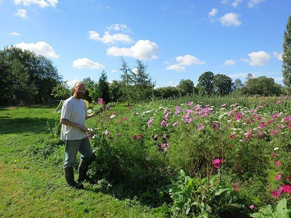 Julian Gurr picking flowers