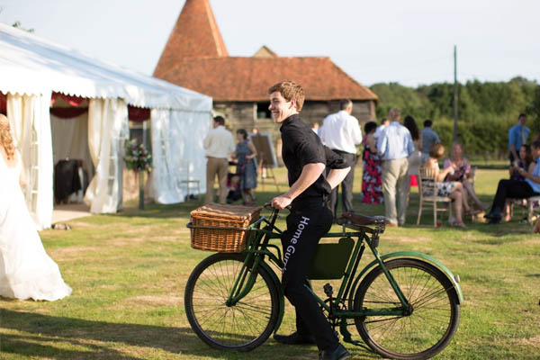 wedding staff on old butchers bike