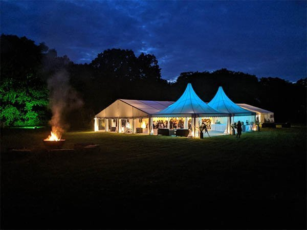 helena and jamie wedding marque at night