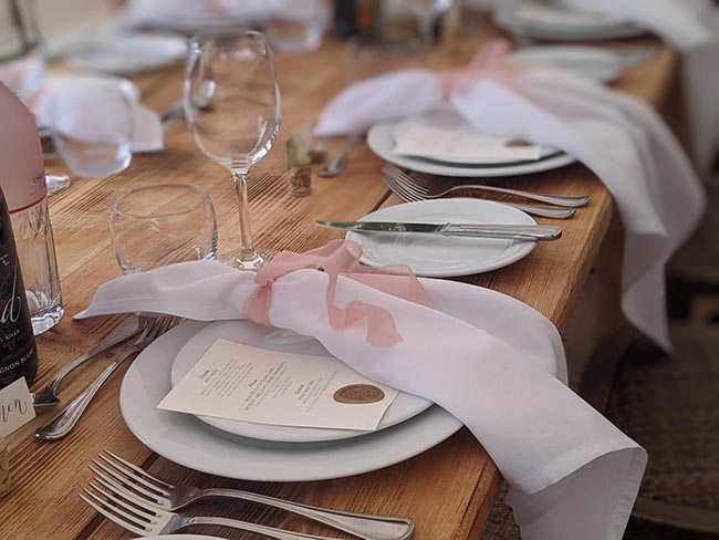 Wedding table with napkin, glasses and plates